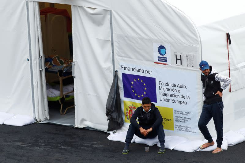 Migrants are seen at a tent in the Canarias 50 Camp, after being transferred from hotels on the south of the island, in Gran Canaria