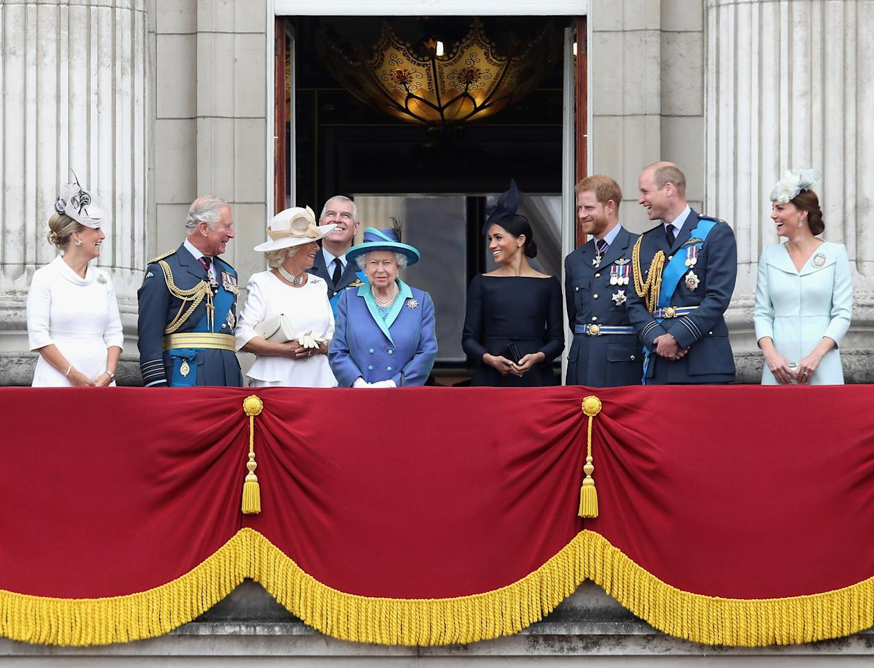 <p>Charles and Meghan exchanged a smiley glance on the balcony of Buckingham Palace during the Royal Air Force celebration in July 2018.</p>
