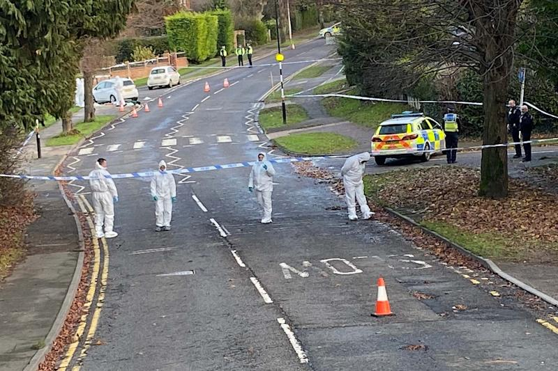 Police at the scene after Levi Davis was stabbed to death in the street (PA)