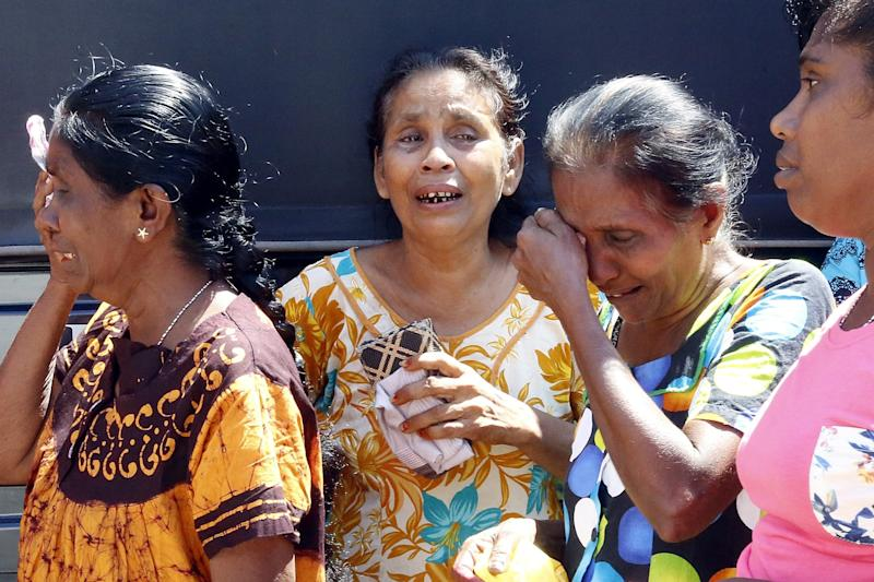 Devastated relatives weep after a series of blasts in Colombo, Sri Lanka, killed almost 300 (EPA)