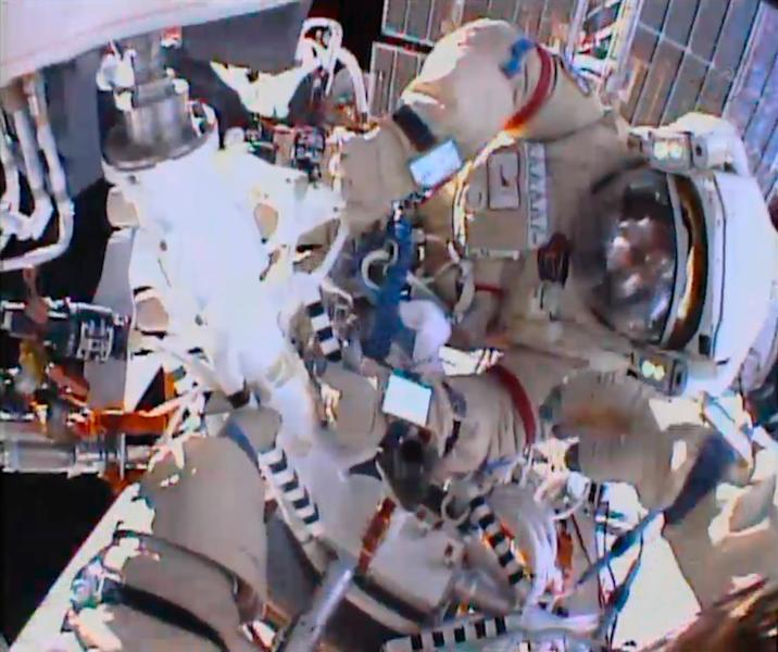 In this image from video made available by NASA, cosmonauts Fyodor Yurchikhin and Aleksandr Misurkin participate in a spacewalk outside the International Space Station on Thursday, Aug. 22, 2013. (AP Photo/NASA)