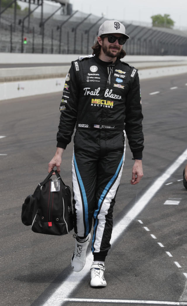 JR Hildenbrand carries his gear out of the pit area during practice for the IndyCar Indianapolis 500 auto race at Indianapolis Motor Speedway, in Indianapolis Tuesday, May 15, 2018. (AP Photo/Michael Conroy)