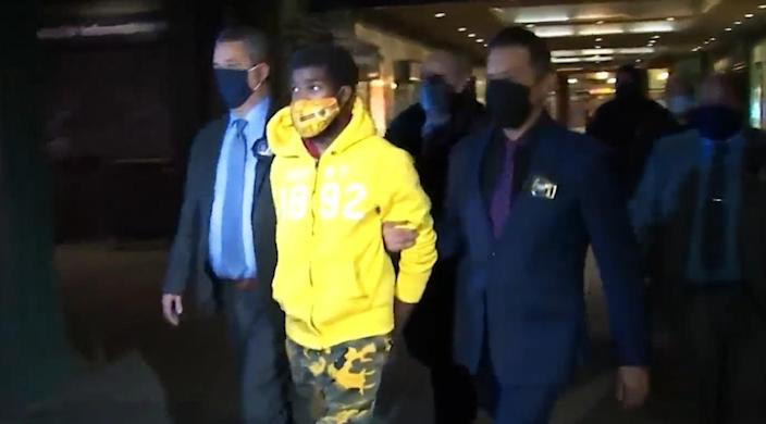 Police lead Khari Covington away from the NYPD station in the Coney Island subway station on Jan. 6, 2021, in Brooklyn. (WNBC)