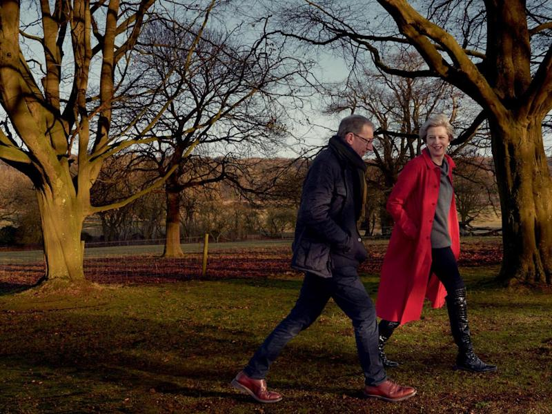 Theresa May with her husband Philip. Mrs May is wearing an Egg coat and a Sine for Egg sweater as she was photographed by Annie Leibovitz for American Vogue (Annie Leibovitz/Vogue)