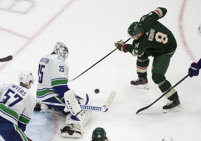 Minnesota Wild's Mikko Koivu (9) is stopped by Vancouver Canucks goalie Jacob Markstrom (25) during the first period of an NHL hockey playoff game Friday, Aug. 7, 2020, in Edmonton, Alberta. (Jason Franson/Canadian Press via AP)
