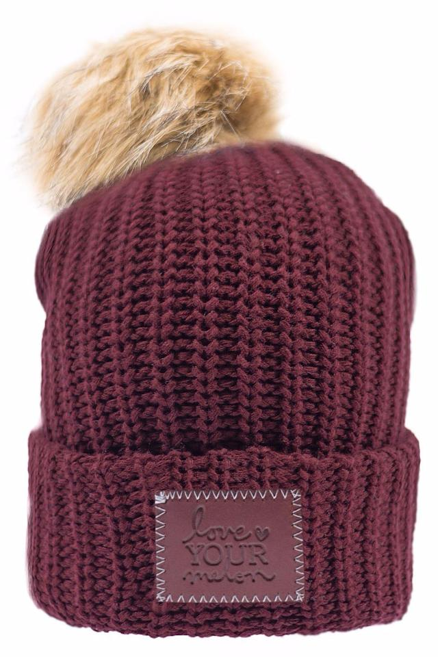 """<p><strong>BUY NOW: </strong><span><em>$45, <a rel=""""nofollow"""" href=""""https://www.loveyourmelon.com/collections/pom-beanies/products/burgundy-pom-cuffed-beanie"""">loveyourmelon.com</a></em></span></p><p><span><a rel=""""nofollow"""" href=""""https://www.loveyourmelon.com/"""">Love Your Melon</a> donates 50 percent of its profits to support pediatric cancer research and families affected by cancer.</span></p>"""