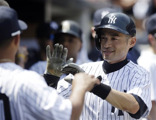 New York Yankees' Ichiro Suzuki, of Japan, celebrates with teammates after scoring on an RBI single by Zoilo Almonte during the third inning of a baseball game against the Tampa Bay Rays Saturday, June 22, 2013, in New York. (AP Photo/Frank Franklin II)