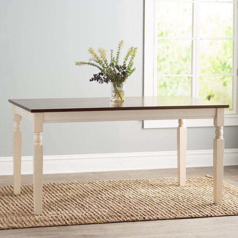 """<p><strong>Rosecliff Heights</strong></p><p>wayfair.com</p><p><a href=""""https://go.redirectingat.com?id=74968X1596630&url=https%3A%2F%2Fwww.wayfair.com%2Ffurniture%2Fpdp%2Frosecliff-heights-leamont-dining-table-w004923239.html&sref=https%3A%2F%2Fwww.delish.com%2Fkitchen-tools%2Fcookware-reviews%2Fg36277927%2Fway-day-kitchen-deals-2021%2F"""" rel=""""nofollow noopener"""" target=""""_blank"""" data-ylk=""""slk:Shop Now"""" class=""""link rapid-noclick-resp"""">Shop Now</a></p><p><strong><del>$387</del> $231 (41% off)</strong></p><p>If you're after a dining room table that'll channel coastal farmhouse feels, reviewers praise this budget-friendly option for its appearance and ability to comfortably seat 6. </p>"""