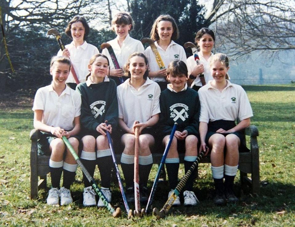 <p>Middleton (front row, center) played field hockey for years growing up. This team photo from her days at St. Andrew's Prep School was taken on St. Andrew's Day, where the school observed a day of activities and sports.</p>