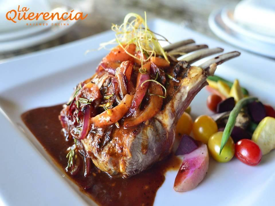 "<p>Miguel Ángel Guerrero Yaguës, the chef–proprietor of this <a href=""http://www.thedailymeal.com/free-tagging-cuisine/tijuana"" rel=""nofollow noopener"" target=""_blank"" data-ylk=""slk:Tijuana"" class=""link rapid-noclick-resp""><strong>Tijuana</strong></a> original, may have coined the term ""BajaMed."" He was certainly one of the earliest practitioners of this tantalizing hybrid cuisine. <a href=""http://www.laquerenciasd.com/"" rel=""nofollow noopener"" target=""_blank"" data-ylk=""slk:La Querencia"" class=""link rapid-noclick-resp""><strong>La Querencia</strong></a> has a hip, contemporary-industrial look: bare concrete floors, lacquered steel tables, and exposed ducts overhead. Subtle, low-tech touches abound, like mounted game trophies on the walls, a tropical fish tank at one end of the dining room, and a row of rusty old cooking implements hanging above the divider that separates the open stainless steel kitchen from the dining room. The focus here is on fresh Baja seafood — scallop carpaccio, <a href=""http://www.thedailymeal.com/recipes/grilled-shrimp-salad-sweet-tea-vinaigrette-recipe"" rel=""nofollow noopener"" target=""_blank"" data-ylk=""slk:grilled shrimp salad"" class=""link rapid-noclick-resp""><strong>grilled shrimp salad</strong></a>, <a href=""http://www.thedailymeal.com/cook/easy-cajun-recipes-anyone-can-make"" rel=""nofollow noopener"" target=""_blank"" data-ylk=""slk:Cajun salmon"" class=""link rapid-noclick-resp""><strong>Cajun salmon</strong></a>, a mixed seafood plate with red and white miso sauces, and hot chiles. Also available are dishes like fresh pasta with several sauces to choose from, like roasted tomato sauce or pesto, lamb chop in pesto sauce, and <a href=""http://www.thedailymeal.com/eat/america-s-best-tacos"" rel=""nofollow noopener"" target=""_blank"" data-ylk=""slk:a range of tacos"" class=""link rapid-noclick-resp""><strong>a range of tacos</strong></a>, tostadas, and burritos employing such uncommon fillings as smoked marlin, giant squid, manta ray, tuna fin stew, and abalone ""chorizo"" — all of it delicious. </p>"