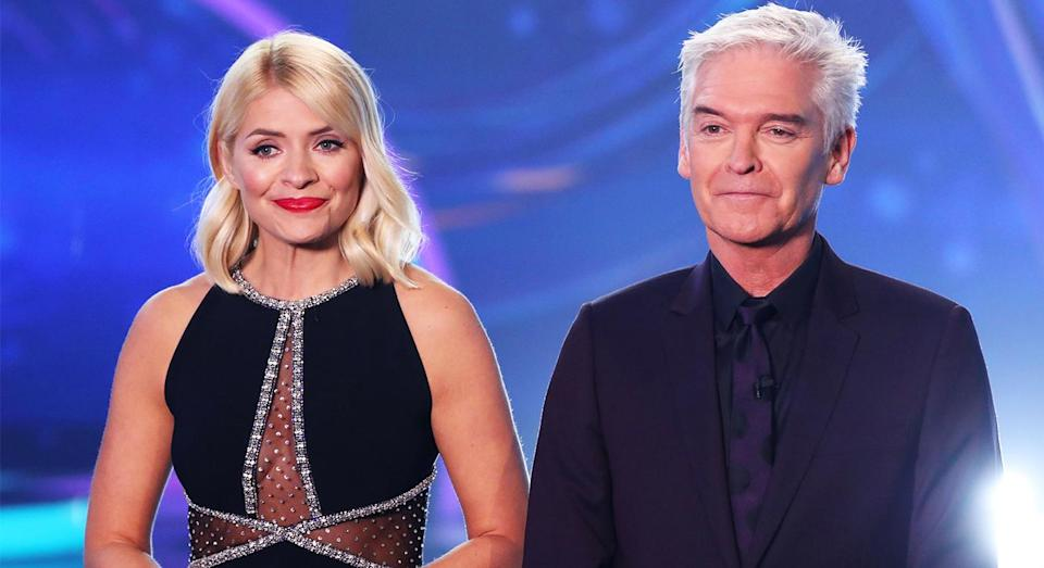 Holly Willoughby wore a cleavage baring dress on Dancing On Ice. [Photo: Rex]