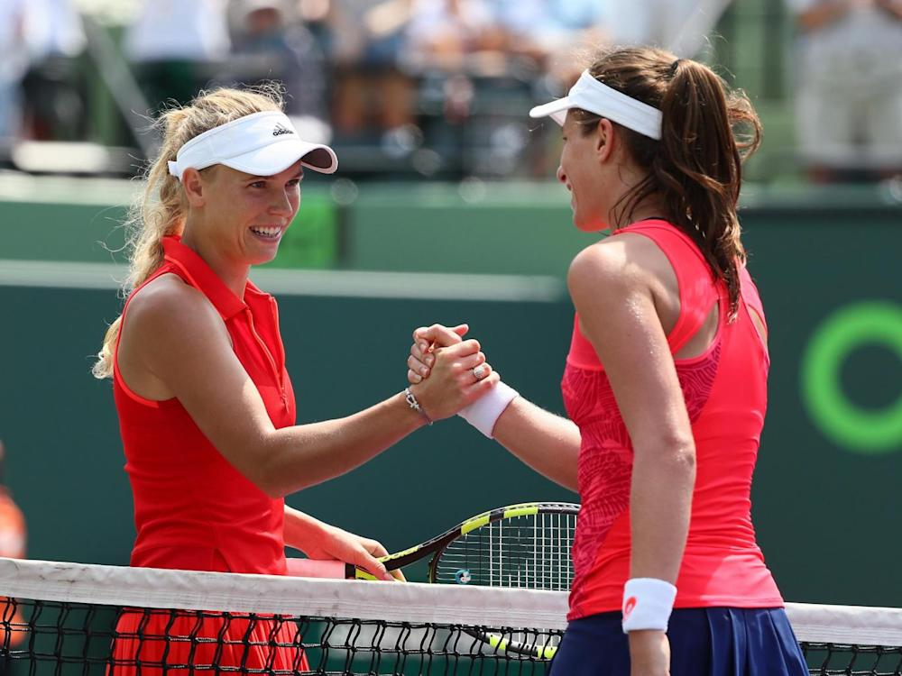 The pair shake hands after an entertaining final (Getty)