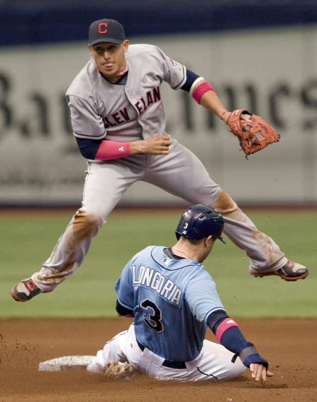 Cleveland Indians shortstop Asdrubal Cabrera, top, watches his throw to first base after forcing out Tampa Bay Rays' Evan Longoria (3) at second base on a double play during the fourth inning of a baseball game on Sunday, May 11, 2014, in St. Petersburg, Fla. (AP Photo/Steve Nesius)