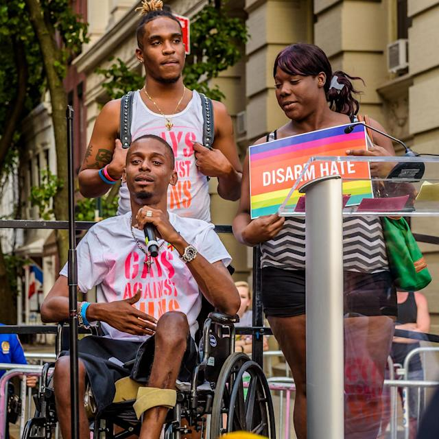 <p>Pulse survivor Keinon Carter speaks during a rally Gays Against Guns and 20 partnering LGBTQ nightclubs participated in for the one year anniversary remembering the 49 victims of the Orlando Pulse Nightclub massacre on June 12, 2017. (Photo: Erik McGregor/Pacific Press/LightRocket via Getty Images) </p>