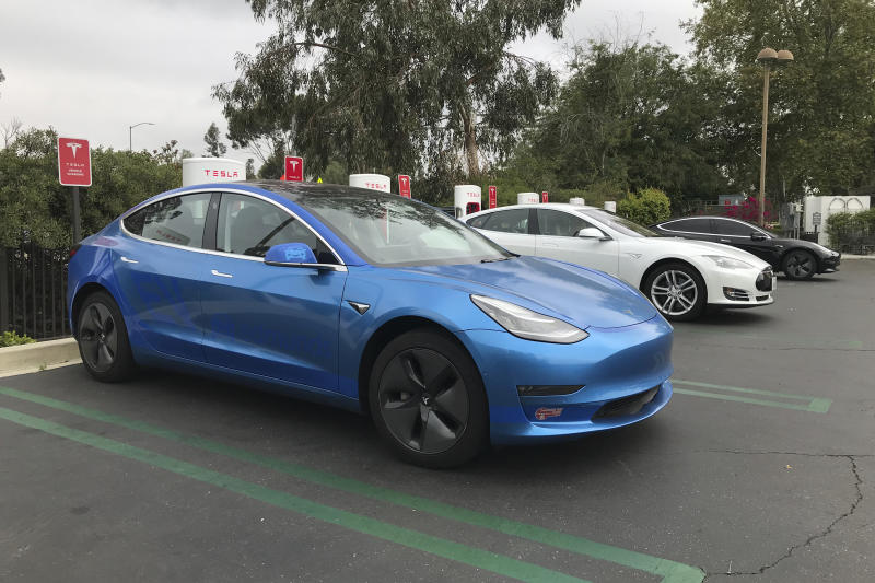 This undated photo provided by Edmunds shows a 2017 Tesla Model 3 at one of the many supercharger stations across the country. Tesla vehicles have a slight edge on public chargers, compared to other EVs, due to their widespread availability and faster charge speeds. (Ronald Montoya/Edmunds via AP)