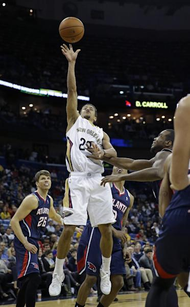 New Orleans Pelicans guard Brian Roberts (22) shoots during the second half of an NBA basketball game against the Atlanta Hawks in New Orleans, Wednesday, Feb. 5, 2014. The Pelicans won 105-100. (AP Photo/Gerald Herbert)