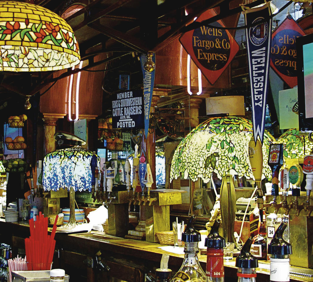 This photo provided by Christie's shows Tiffany lamps behind San Francisco's popular Eddie Rickenbacker bar. On June 14, Christie's auction house in New York will sell the collection of six Tiffany lamps and one chandelier that once decorated the bar that was owned by Norman Jay Hobday, who died in February 2011. The collection is expected to bring more than $2 million. (AP Photo/Christie's, Susannah Chen)
