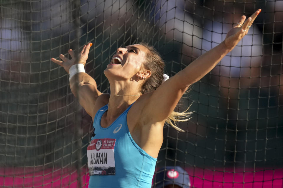 Valarie Allman celebrates during the finals of women's discus throw at the U.S. Olympic Track and Field Trials Saturday, June 19, 2021, in Eugene, Ore. (AP Photo/Charlie Riedel)