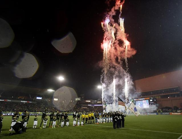 Fireworks go off during the National Anthem for the Portland Timbers home opener MLS soccer game against the Philadelphia Union in Portland, Ore., Saturday, March 8, 2014. (AP Photo/Don Ryan)