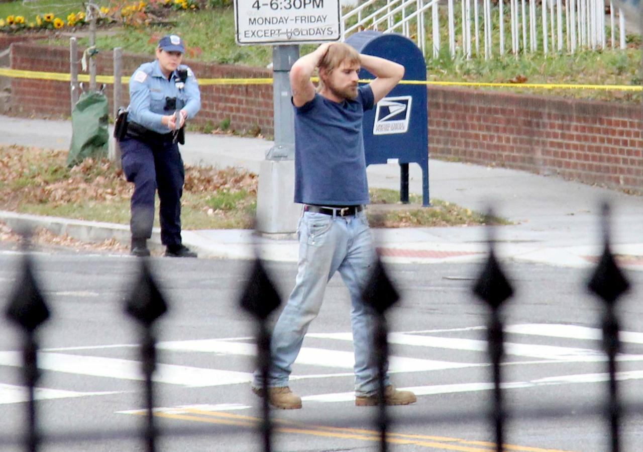 <p>Edgar Maddison Welch, 28 of Salisbury, N.C., surrenders to police Sunday, Dec. 4, 2016, in Washington. Welch, who said he was investigating a conspiracy theory about Hillary Clinton running a child sex ring out of a pizza place, fired an assault rifle inside the restaurant on Sunday injuring no one, police and news reports said. (Sathi Soma via AP) </p>