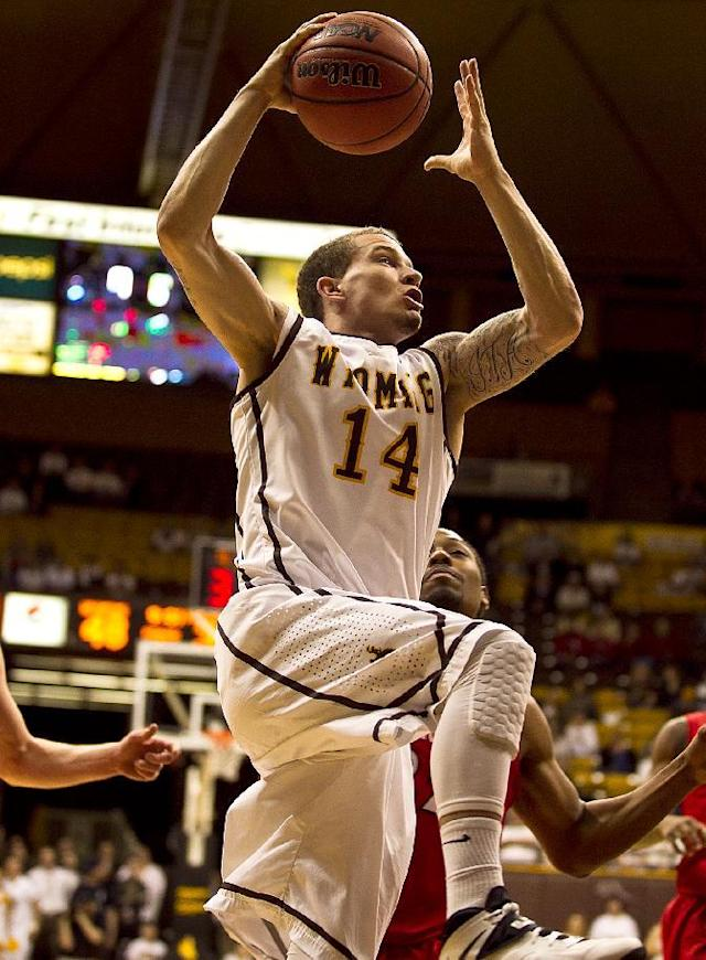 University of Wyoming guard Josh Adams (14) carries the ball up to the net Tuesday, Feb. 11, 2014 against San Diego State at the Arena-Auditorium in Laramie, Wyo. (AP Photo/Jeremy Martin)