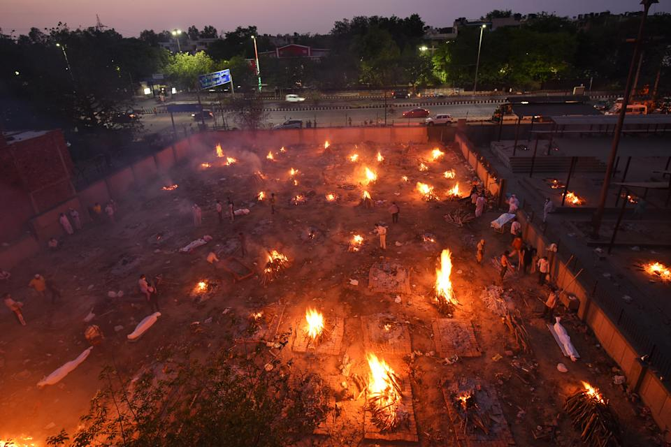 NEW DELHI, INDIA - APRIl 23: COVID-19 victims being cremated at Seemapuri crematorium, on April 23, 2021 in New Delhi, India. (Photo by Amal KS/Hindustan Times via Getty Images)