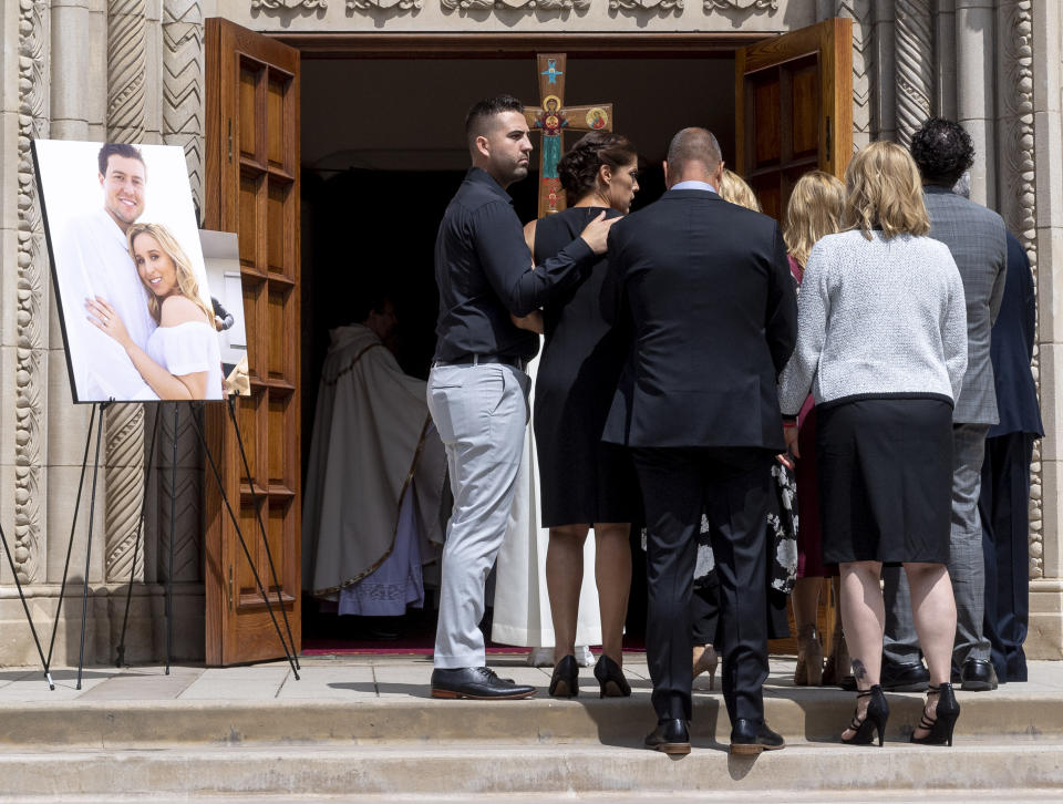 SANTA MONICA, CA - JULY 22: Debbie Hetman, second from left, mother of Los Angeles Angels pitcher Tyler Skaggs enters a memorial service for Skaggs at St. Monica Catholic Church in Santa Monica, CA on Monday, July 22, 2019. Skaggs, 27, was found unresponsive in his hotel room in Texas on July 1, 2019. (Photo by Paul Bersebach/MediaNews Group/Orange County Register via Getty Images)