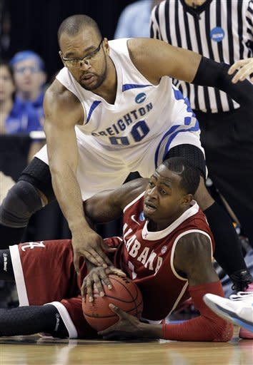 Alabama's JaMychal Green (1) looks to pass as he is trapped by Creighton's Gregory Echenique (0) during the first half of a Midwest Regional NCAA tournament second-round college basketball game in Greensboro, N.C., Friday, March 16, 2012. (AP Photo/Chuck Burton)
