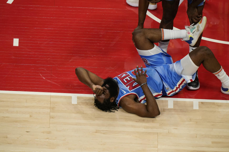 Brooklyn Nets' James Harden lies on the court after being fouled during the first half of the team's NBA basketball game against the Atlanta Hawks on Wednesday, Jan. 27, 2021, in Atlanta. (AP Photo/Brynn Anderson)