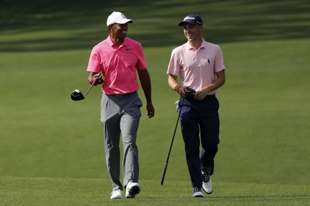 Tiger Woods of the U.S. (L) shares a laugh with compatriot Justin Thomas as they walk to the 8th tee during practice for the 2018 Masters golf tournament at Augusta National Golf Club in Augusta, Georgia, U.S. April 2, 2018. REUTERS/Jonathan Ernst