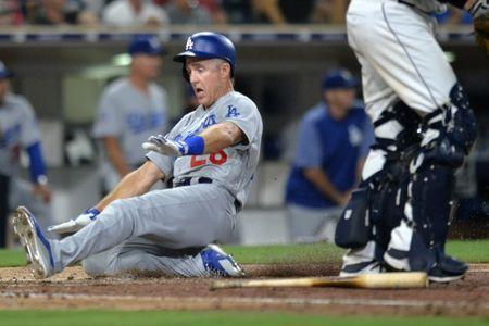 Jul 9, 2018; San Diego, CA, USA; Los Angeles Dodgers second baseman Chase Utley (26) slides in safely to score on a single by third baseman Justin Turner (not pictured) during the eighth inning at Petco Park. Mandatory Credit: Jake Roth-USA TODAY Sports