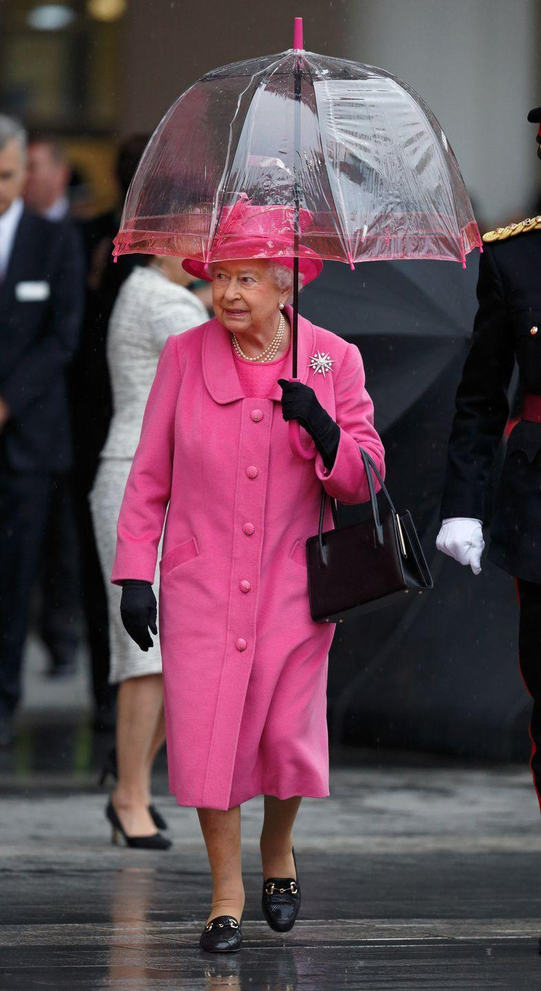 """<p>The rain can't hold the Queen back—<a href=""""https://www.townandcountrymag.com/society/tradition/a26899647/queen-elizabeth-umbrellas-fulton-match-outfit/"""" rel=""""nofollow noopener"""" target=""""_blank"""" data-ylk=""""slk:she even coordinated her umbrella with her fuchsia look."""" class=""""link rapid-noclick-resp"""">she even coordinated her umbrella with her fuchsia look. </a></p>"""