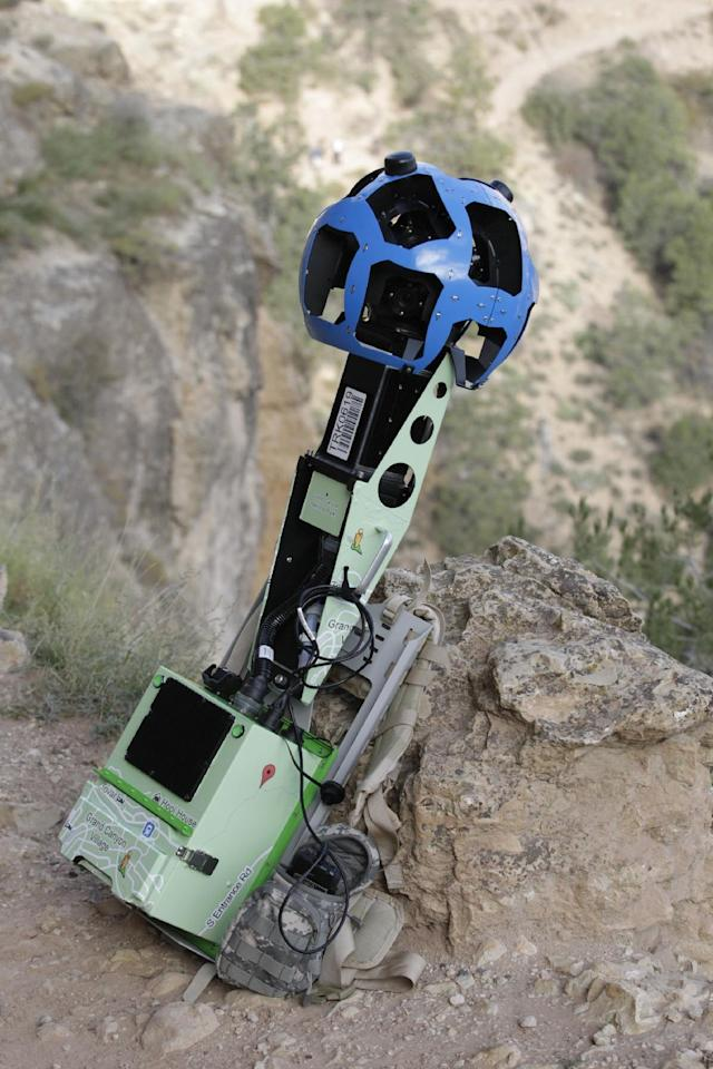 This Monday Oct. 22, 2012, photo shows the Google Trekker during a demonstration for the media along the Bright Angel Trail at the South Rim of the Grand Canyon National Park in Arizona. The search engine giant is using the nearly 40-pound, backpack-sized camera unit to showcase the Grand Canyon's most popular hiking trails on the South Rim and other off-road sites. It's about 4 feet in height when set on the ground, and when worn, the camera system extends 2 feet above the operator's shoulders. (AP Photo/Rick Bowmer)