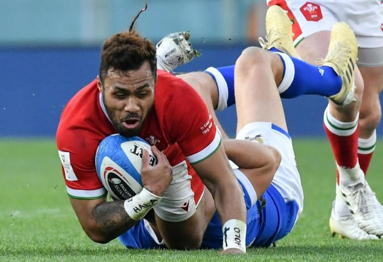 Italy's Marcello Violi (Bottom) tackles Wales' Willis Halaholo in Rome