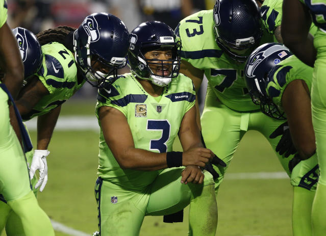The Seattle Seahawks have been fined for not properly following concussion protocol after game referee Walt Anderson suspected quarterback Russell Wilson, center, suffered a brain injury on Nov. 9 against Arizona. (AP)
