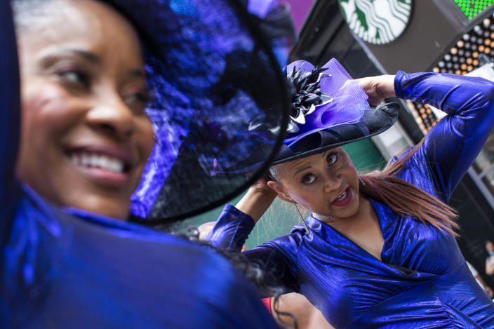 Women wait to perform during a free outdoor event organized by The Broadway League during Juneteenth celebrations at Times Square on Saturday, June 19, 2021, in New York. Parades, picnics and lessons in history marked Juneteenth celebrations in the U.S., a day that marks the arrival of news to enslaved Black people in a Texas town that the Confederacy had surrendered in 1865 and they were free. (AP Photo/Eduardo Munoz Alvarez)