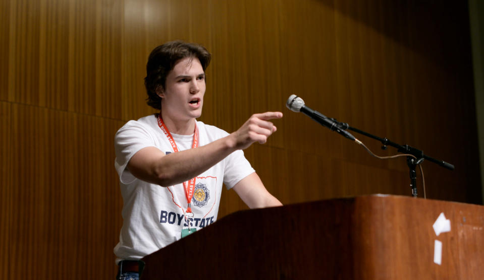 "This image released by A24 shows Robert MacDougall in a scene from ""Boys State."" One of the biggest sales from this year's Sundance Film Festival, this documentary takes us into an American Legion-sponsored leadership experiment where 1,100 teenage boys head to Austin, Texas to ""run"" for governor. Described as a ""political coming-of-age story,"" ""Boys State,"" on Apple TV+ Friday, is an entertaining and eye-opening glimpse at politics, youth and possibly our future. (A24 via AP)"