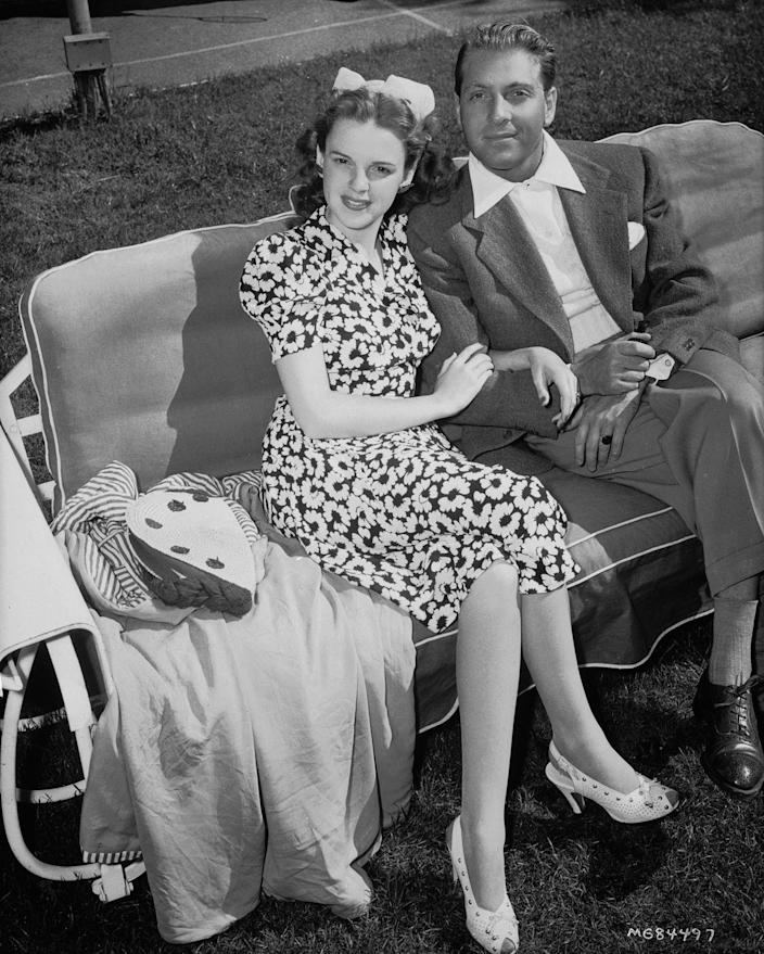 <p>Judy sits with her first husband, bandleader David Rose. She became a bride for the first time at 19 years old. The marriage would last until 1944 when she divorced Rose. </p>