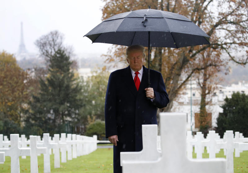 President Donald Trump stands among headstones during an American Commemoration Ceremony on Sunday at Suresnes American Cemetery near Paris, one day after skipping another World War I ceremony because of rain. (The Associated Press)