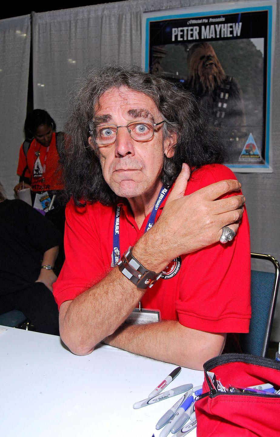 """<p>At 7' 3"""", Mayhew was uniquely qualified to bring Chewbacca to life, and his large stature was only part of the role, as his epic grunts really helped make Chewie one of the most beloved characters in the fandom. Before his passing Mayhew suffered from many knee issues and the 7 foot tall Joonas Suotamo stepped into the hairy wookie suit during <em>The Force Awakens</em>.</p>"""