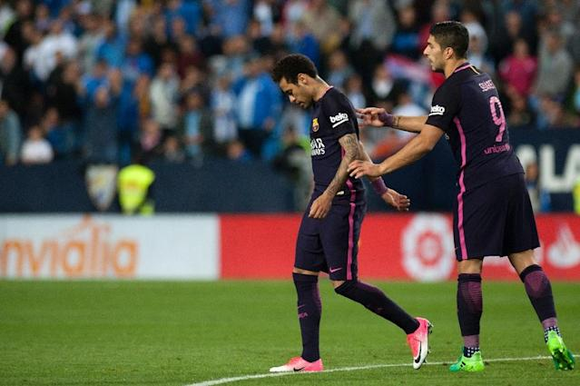 Barcelona's Neymar da Silva (L) was shown a red card during a defeat against Malaga and has since been serving a three-match ban (AFP Photo/JORGE GUERRERO)