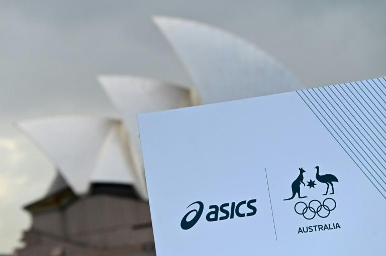 The logos of Japanese sportswear company ASICS and the Australian Olympic Committee are seen in front of the Sydney Opera House during the unveiling ceremony of the Australian team uniforms for the Tokyo Games