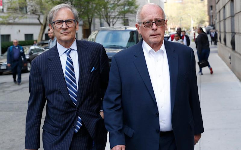 Former Rochester Drug Co-Operative CEO Laurence Doud III, right, leaves court in New York - AP