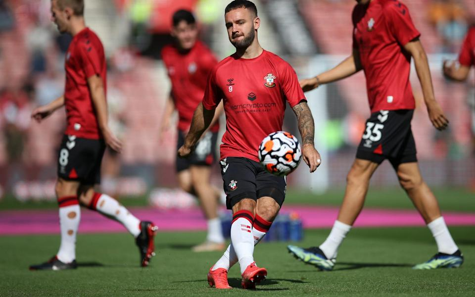 Adam Armstrong of Southampton warms up prior to the Premier League match between Southampton and Wolverhampton Wanderers at St Mary's Stadium. - Steve Bardens/Getty Images