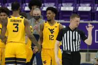 West Virginia forward Gabe Osabuohien (3) and guard Taz Sherman (12) celebrate a three-point basket scored by Sherman with the addition of a foul charged to TCU in the second half of an NCAA college basketball game in Fort Worth, Texas, Tuesday, Feb. 23, 2021. (AP Photo/Tony Gutierrez)
