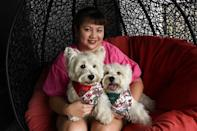 Sasha and Piper's owner, Carrie Er, stumbled into the business several years ago when she started posting pictures of Sasha in costumes (AFP/Catherine LAI)