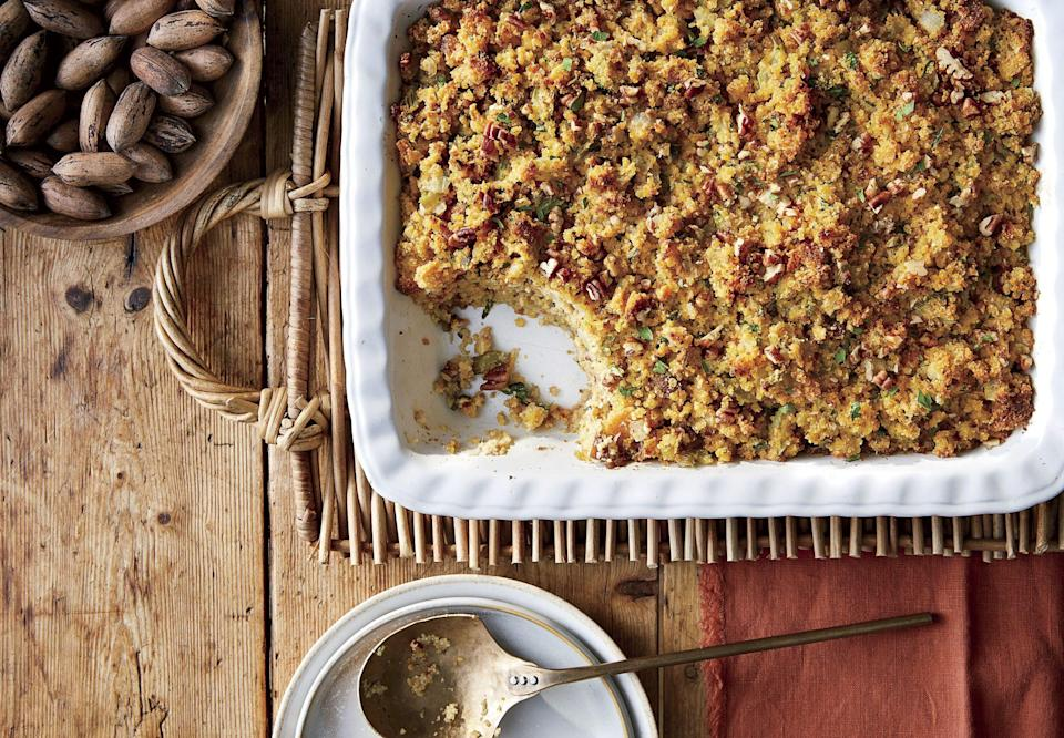 """<p><strong>Recipe: <a href=""""https://www.southernliving.com/recipes/herby-pecan-cornbread-dressing"""" rel=""""nofollow noopener"""" target=""""_blank"""" data-ylk=""""slk:Herby Pecan-Cornbread Dressing"""" class=""""link rapid-noclick-resp"""">Herby Pecan-Cornbread Dressing</a></strong></p> <p>Say hello to this even more Southern recipe for cornbread dressing that gets wonderful crunch from toasted pecans. You'll want to serve this beyond the holidays. </p>"""