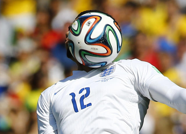 England's Chris Smalling heads the ball during their 2014 World Cup Group D soccer match against Costa Rica at the Mineirao stadium in Belo Horizonte June 24, 2014. REUTERS/Murad Sezer (BRAZIL - Tags: SOCCER SPORT WORLD CUP TPX IMAGES OF THE DAY) TOPCUP