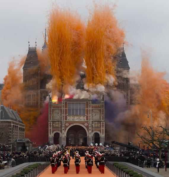 "Fireworks are seen during the official opening of the renovated Rijksmuseum in Amsterdam, Netherlands, Saturday April 13, 2013. The Rijksmuseum, home of Rembrandt's ""The Night Watch"" and other national treasures reopens its doors to the public after a decade-long renovation. The first day, Saturday April 13, admissions are free and the museum stays open until midnight. (AP Photo/Peter Dejong)"