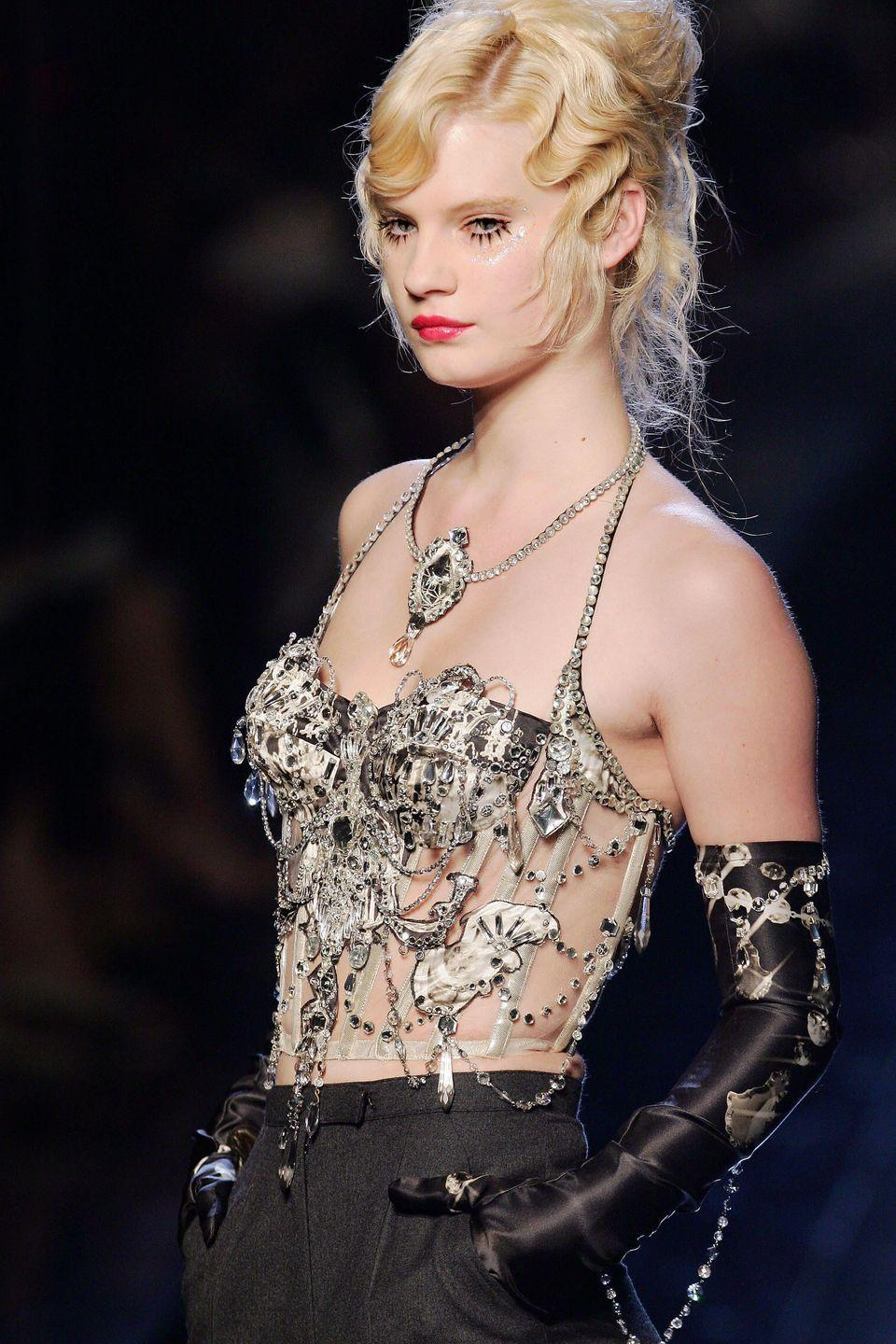 <p>A bustier dripping in crystals, on the designer's Fall 2006 Haute Couture runway.</p>